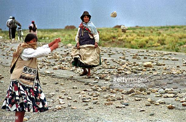 Women farmers are seen on the street where rocks remain from past demonstrations in Batallas Bolivia 05 February 2002 Mujeres campesinas del...