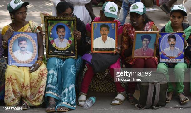 Women farmers from Telangana with the portraits of their family members who according to them committed suicide, during Kissan Rally at Parliament...