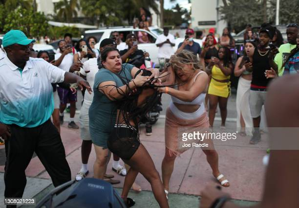 Women fight on the street near Ocean Drive on March 19, 2021 in Miami Beach, Florida. College students have arrived in the South Florida area for the...