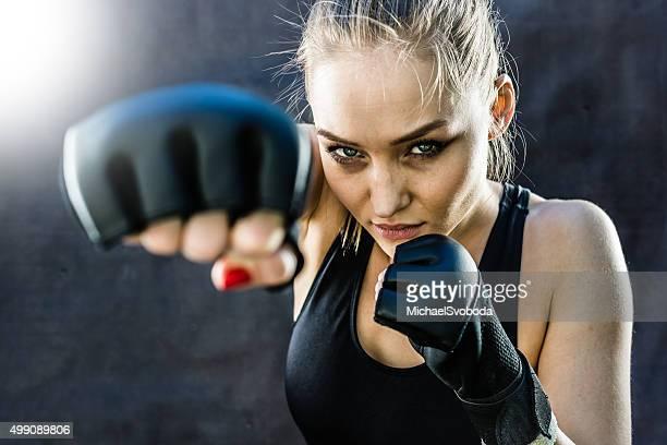 Women Fighter Punching Close Up