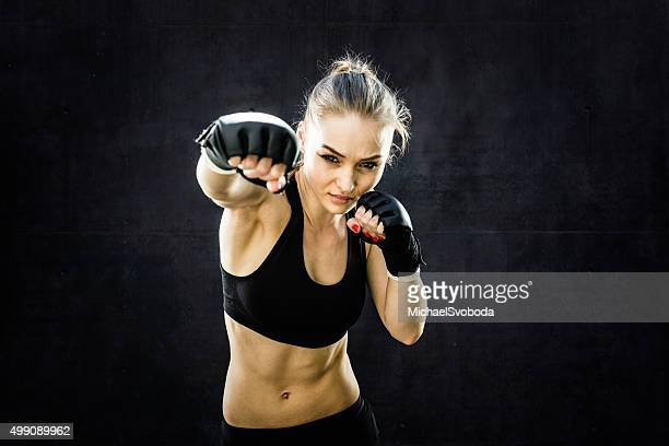 women fighter punching close up - mixed martial arts stock pictures, royalty-free photos & images