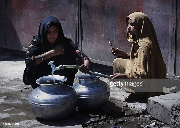 Women filling their jars with water Pakistanis take part in the eve of World Water Day World Water Day is celebrated every 22nd day of March yearly...