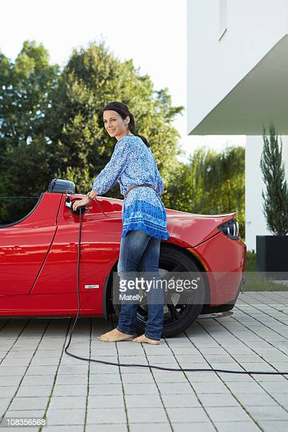 Women filling up her electric car