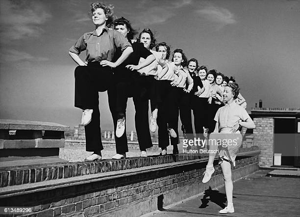 Women firefighters exercise on the roof of their headquarters in Walthamstow 1944