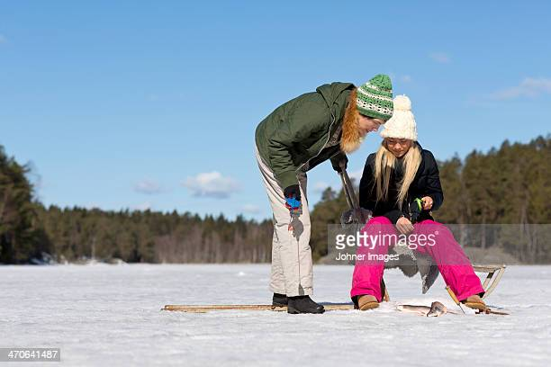 Women fishing at winter