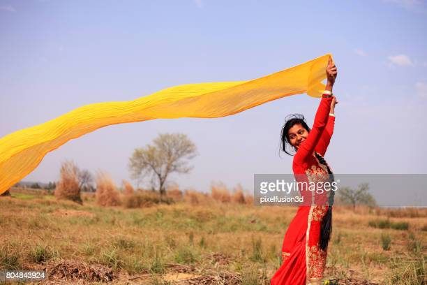 women flying colorful clothes in nature - salwar kameez stock pictures, royalty-free photos & images