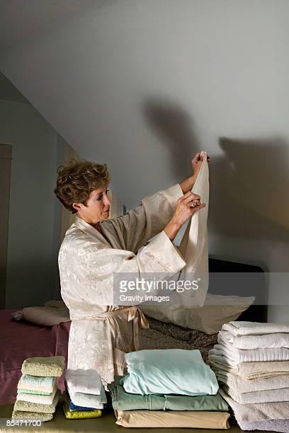 Women folding laundry at night