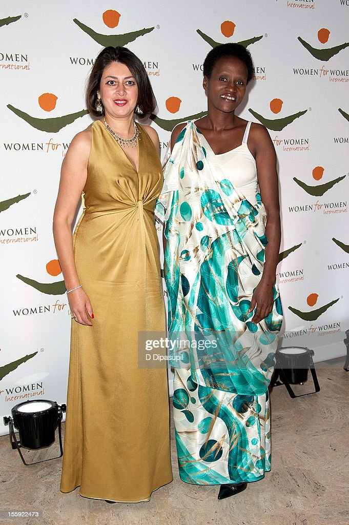 Women For Women International CEO Afshan Khan (L) and Rwandan Women for Women International graduate Francoise Tumukunde attend the 2012 Women For Women International gala at Koch Theater, Lincoln Center on November 8, 2012 in New York City.