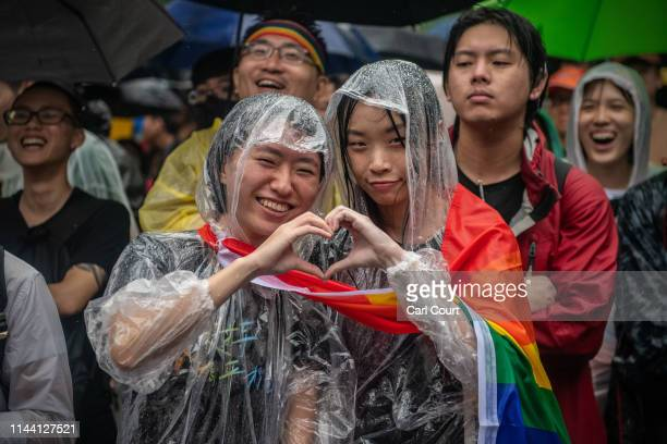 Women form a heart with their hands as they react after Taiwan's parliament voted to legalise samesex marriage on May 17 2019 in Taipei Taiwan Taiwan...