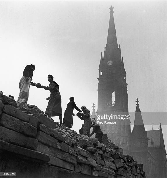 Women form a human chain to carry bricks used in the reconstruction of Dresden March 1946 after allied bombing had destroyed the city in February...