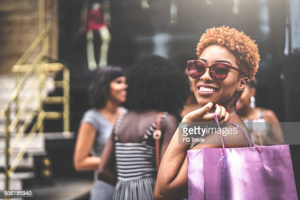 Women friends are so happy after shopping