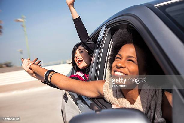 Women friends enjoying vacations during a road trip