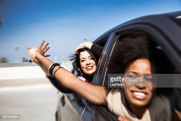 Women friends enjoying vacations during a road trip