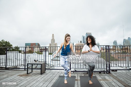 Women Friends Exercise on New York Rooftop