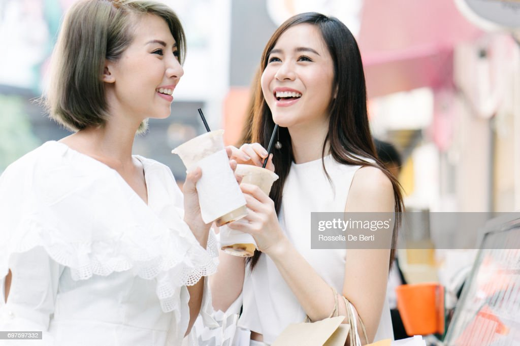 Women friends out for shopping in Bangkok city streets : Stock Photo