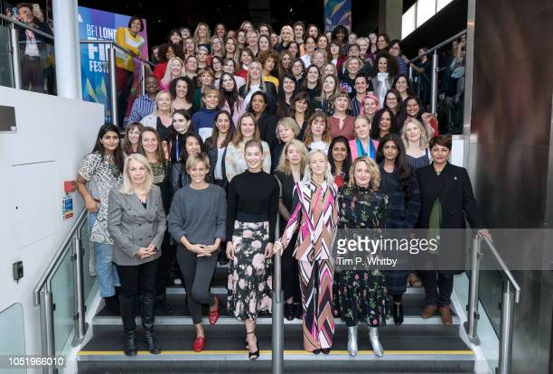 Women from across the film industry including Amanda Nevill Denise Gough Rosamund Pike Andrea Riseborough and Tricia Tuttle pose as the BFI London...