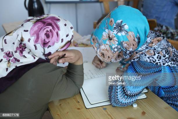 Women from Afghanistan who preferred not to show their faces to the camera attend a class offering literacy and basic computer and Internet skills at...