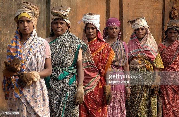 Women from day labor community queue up for their wages at the end of the day Naryanganj Bangladesh February 6 2008