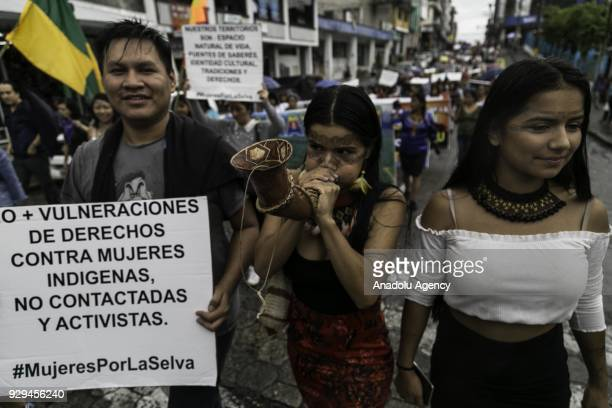 Women from different Amazonian Indigenous communities of Ecuador attend the International Women´s Day march on Atahualpa Street in Puyo Ecuador on...