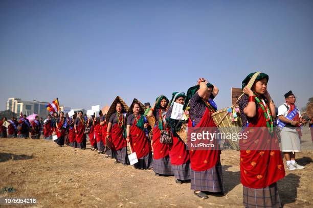 Women from ethnic Gurung community in a traditional attire participate in the rally during Tamu Lhosar or New Year celebrated in Kathmandu Nepal on...