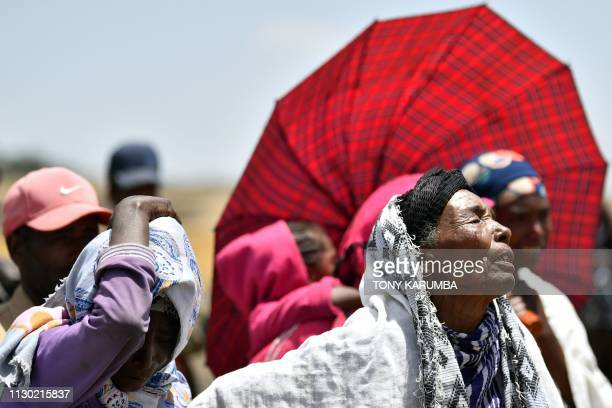 TOPSHOT Women from Hama Quntushele village weep as relatives of the victims of the Sunday plane crash visit the crash site of the Ethiopian Airlines...