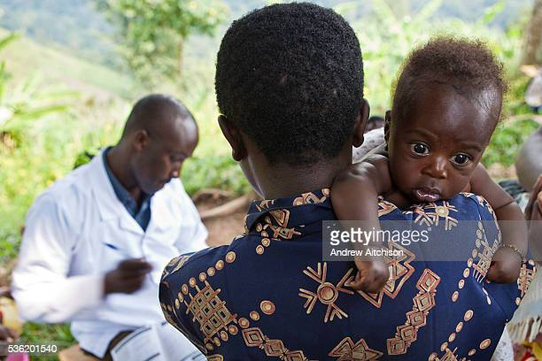 Women from Kitahurira the only Batwa tribe settlement in Mpungu district wait with their children to attend the Bwindi Community Hospital outreach...