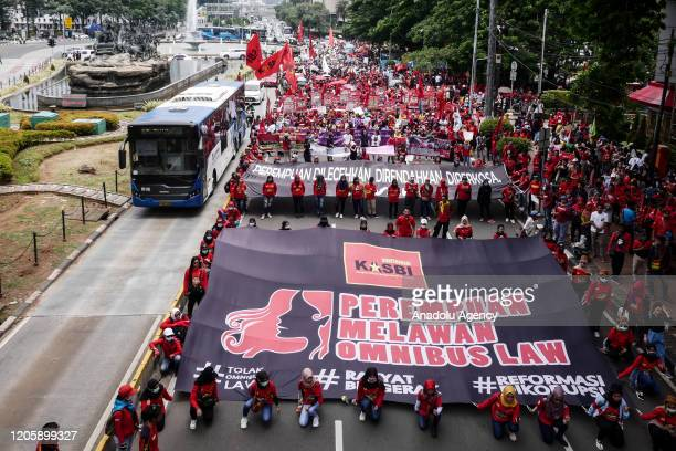 Women from labour union carry posters during the International Women's Day in Jakarta, Indonesia on March 8, 2020. Women from various organizations...