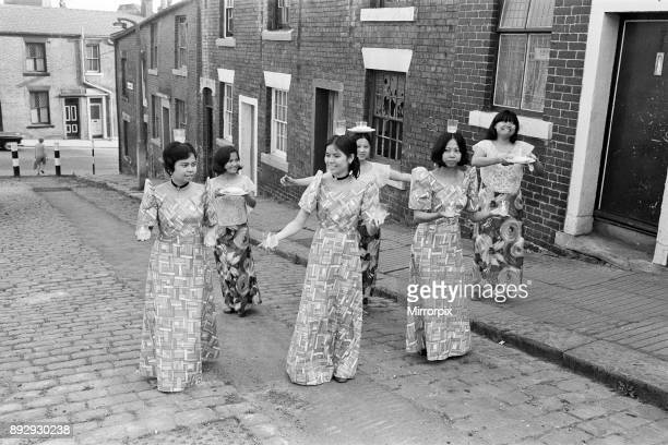 Women from Manila, who work in a Mill in Rochdale, Lancashire, give a display of national dancing in the cobbled streets of Rochdale, 20th July 1972.