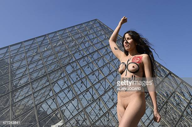 A women from the Arab and Muslim world demonstrates naked in front of the Louvre pyramid on March 8 to denounce women's oppression in muslim...
