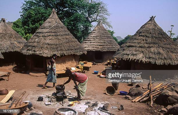 Women from the Bedik tribe cooking with firewood in the village of Iwol, Senegal. The Iwol village rests on top of a mountain near the southeastern...