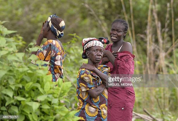 Women from the Christian community react after seeing the bodies of five people three AntiBalaka fighters and two presumed civilians who were killed...