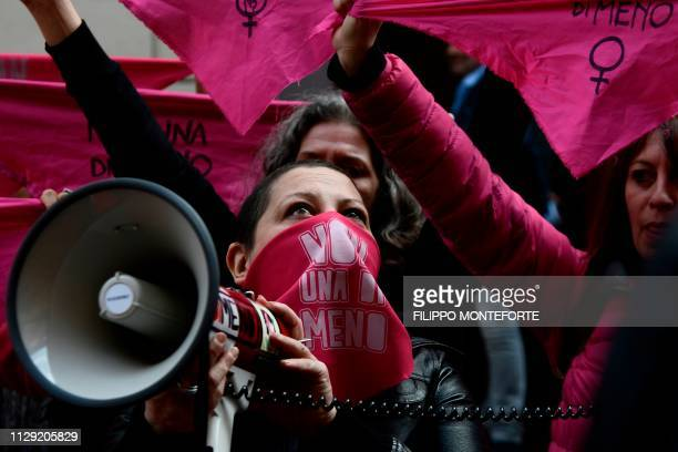 TOPSHOT Women from the feminist movement Non Una Meno stage a gathering in front of the Labour Ministry in Rome on March 8 2019 on International...