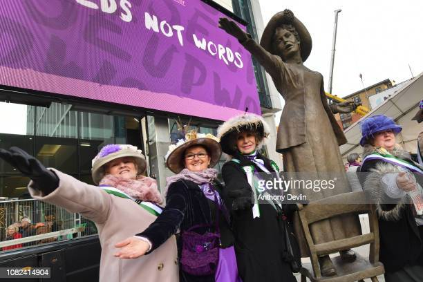 Women from the Friends of Wythenshawe Hall pose during the unveiling of a statue of the suffragette Emmeline Pankhurst entitled 'Our Emmeline' in St...