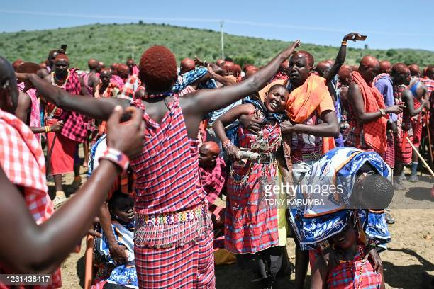 Women from the Kenyan Maasai tribe are overcome with emotion as they as they participate in a rite of passage, for their husbands, to mark the...