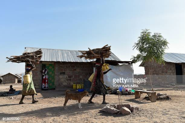 Women from the local Turkana community carry firewood on their heads into the Kalobeyei refugee settlement scheme in Kakuma a collaborative effort by...