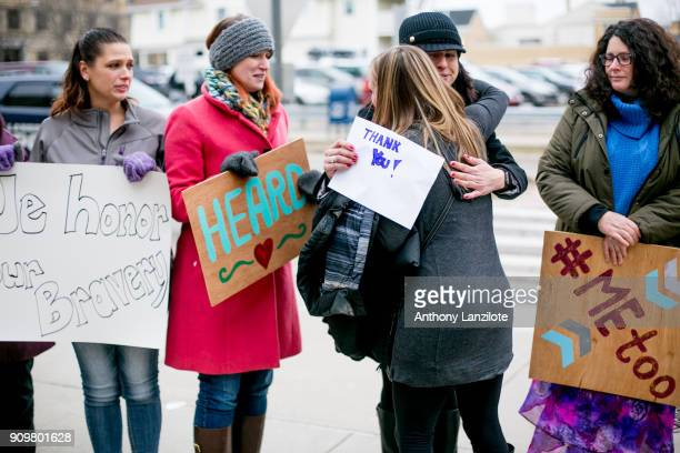 Women from the Michigan based victim advocacy groups End Violent Encounters and Firecracker Foundation cheer for women as they leave the courthouse...