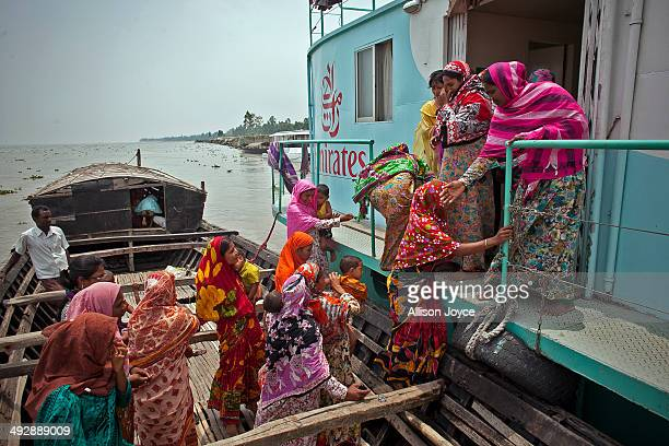 Women from the Modafot village arrive at the Emirates Friendship Floating Hospital May 19 2014 in the Chilmari district Bangladesh Friendship...