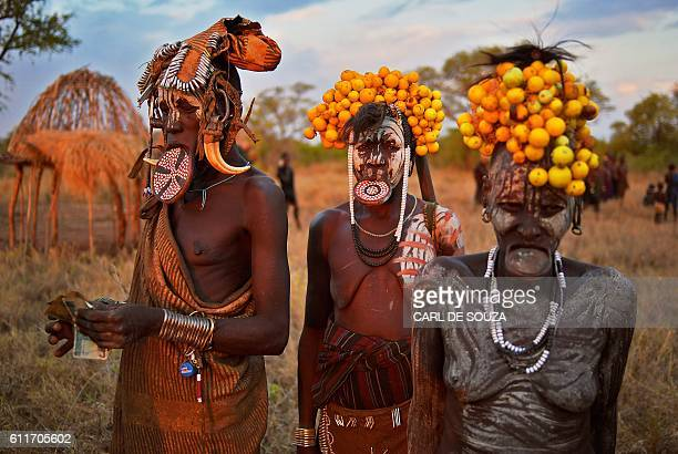 Women from the Mursi tribe pose for a photo in the Mago National park near Jinka in Ethiopia's southern Omo Valley region on September 21 2016 The...