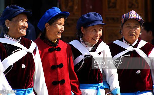 Women from the Naxi minority group in Yinnan, China. They meet and dance daily in the town square.
