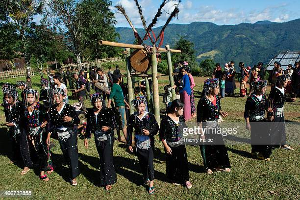 Women from the Palaung ethnic group perform a traditional dance in a Palaung village