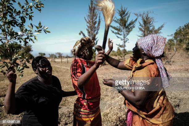 TOPSHOT Women from the Pokot tribe reproduce a part of a circumcision ceremony which has since been prohibited after antifemale genital mutilation...