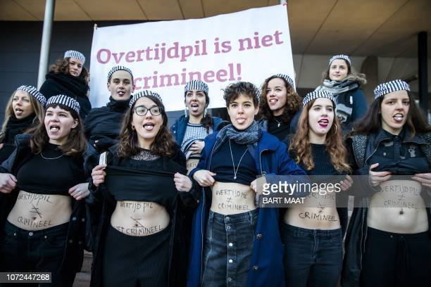 Women from the proabortion groups 'Women on Waves' and 'Bureau Clara Wichmann' show their bellies on which is written 'morningafter pill is not...