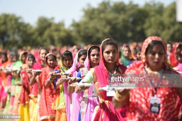 Women from the Shatriya community dance with swords in an attempt to set a world record for the largest number of people taking part in a sword dance...