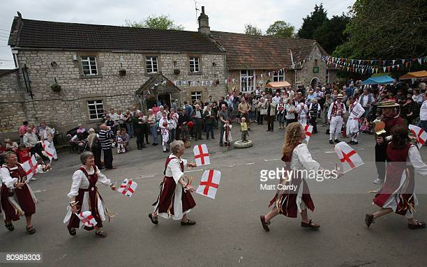 Women from the Somerset Morris dance outside the village pub and hall at the May Day village celebrations in Priston on May 5 2008 in Somerset...