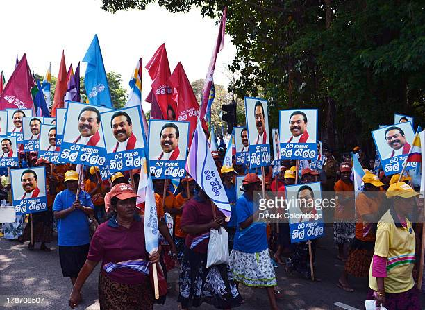 CONTENT] Women from the state services marching in the Sri Lankan government's 2013 May Day parade while carrying posters of President Mahinda...