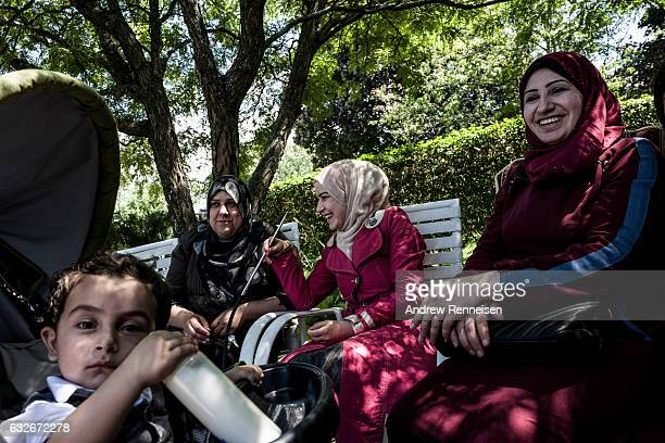 Women from the Syrian refugee community attend a local potluck together on August 1 2015 in Bloomfield Hills Michigan The community is expecting...