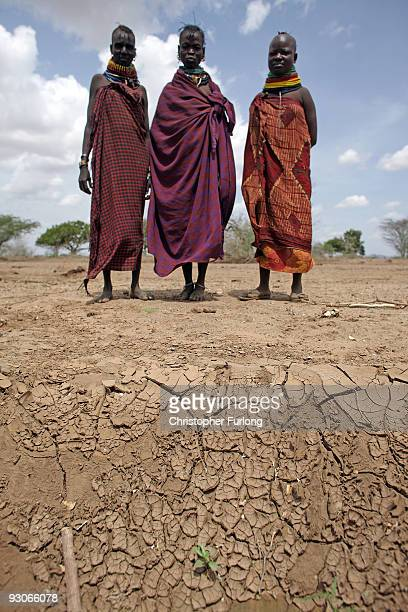 Women from the Turkana area of Kanukurdio show a dried up riverbed to Oxfam workers on November 9 2009 near Lodwar Kenya Over 23 million people...