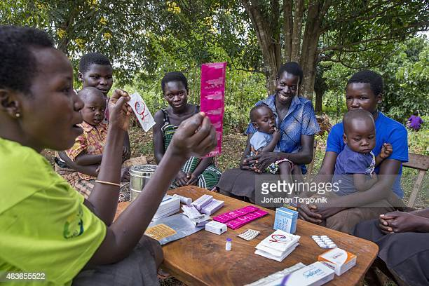 Women from the Young Mothers Group meeting and getting family planning information from a community health worker The program is supported by...