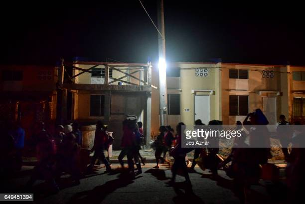 Women from urban poor communities march toward a government housing to mark International Women's Day on March 8 2017 in Bulacan Philippines...