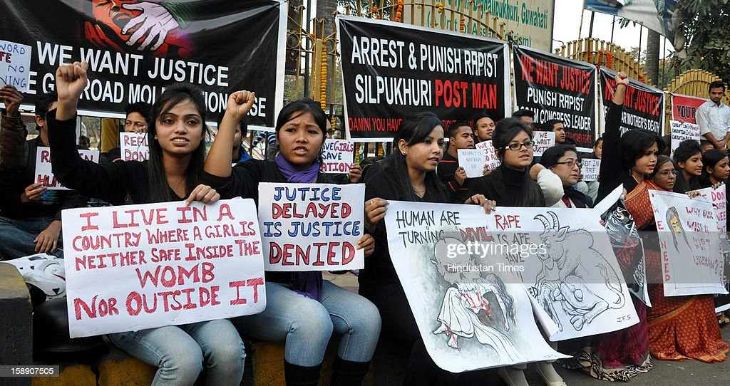 Women from various works of life hold placards during a demonstration demanding justice for the gang-rape victim on January 3, 2013 in Guwahati, India. The protesters are protesting against the sexual harassment of a woman by a Bikram Singh Brahma, in Chirang district of Assam on January 3, 2013. Bikram Singh Brahma, a Congress leader from Chirang district of Assam was arrested by the police for allegedly attempting to rape a woman.